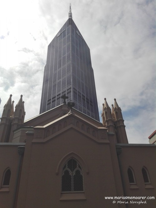 Contrasts of Melbourne: St. Francis' Catholic Church and a scy scraper in background