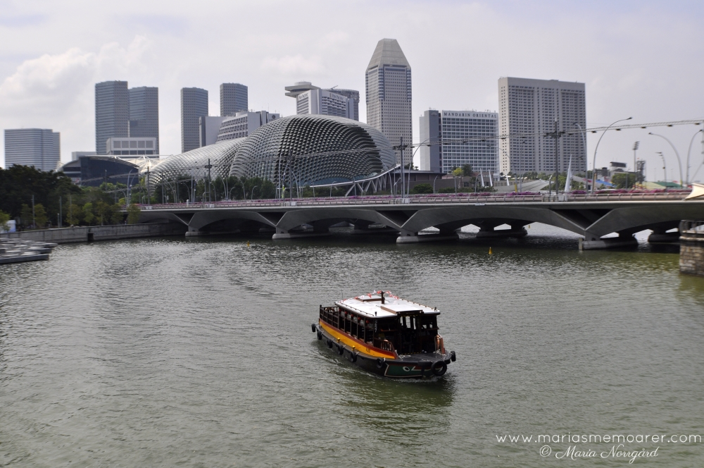 Downtown Singapore - the Esplanade bridge and a river boat