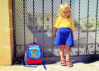 Milla in her school uniform outside her new school, Mgarr primary, in Malta.