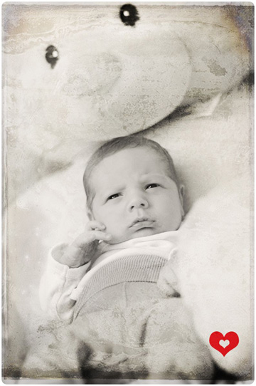 New born baby boy with texture added to photo to make it look old and worn