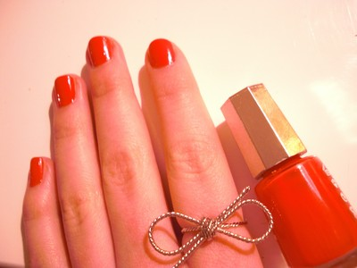 Bow and red nail polish