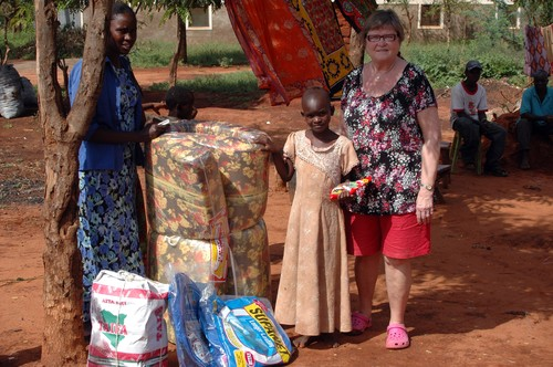 Dropping off mattress and food in Maungo.