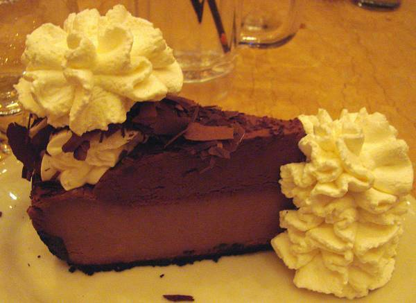 One little piece of cheesecake with chocolate mousse