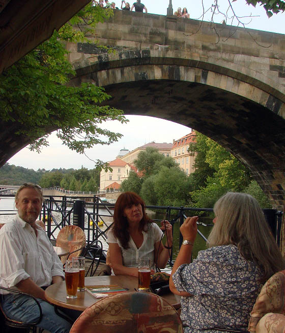Enjoying a beer at Charles Bridge in Prague