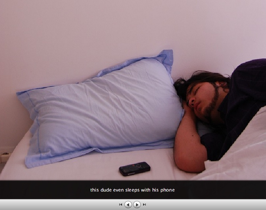 Dude sleeping next to a phone